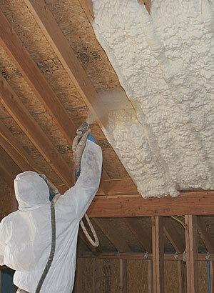 Work spraying foam between studs